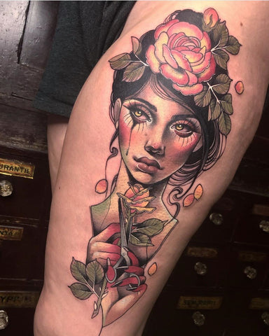 women portrait thigh tattoo