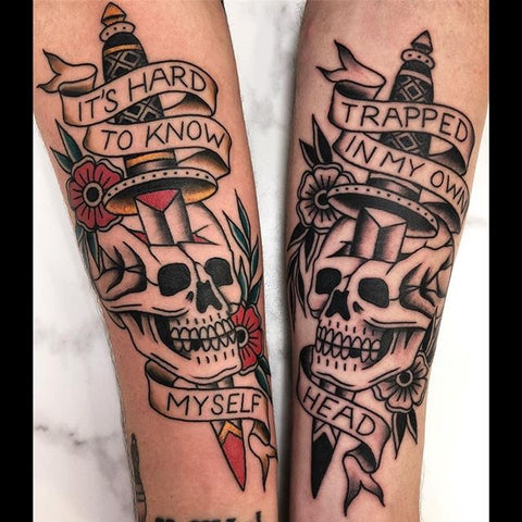 skull with dagger old school arm tattoo