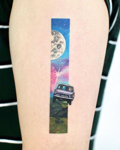 unique moon and car tattoo on arm