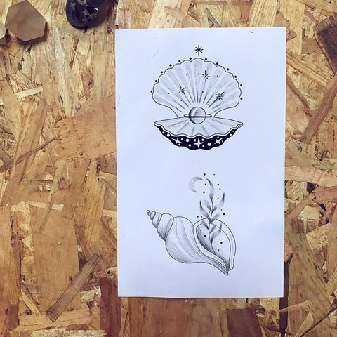 seashell with pearl conch tattoo design