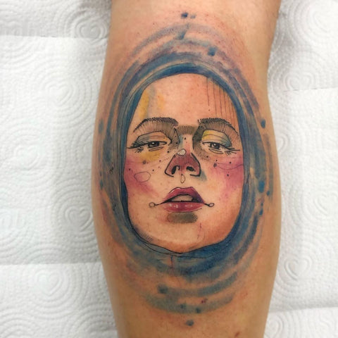 woman face watercolor tattoo