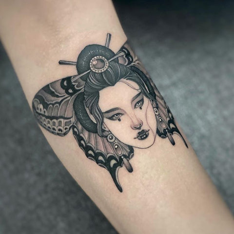 woman face butterfly tattoo