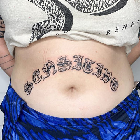 word belly tattoo
