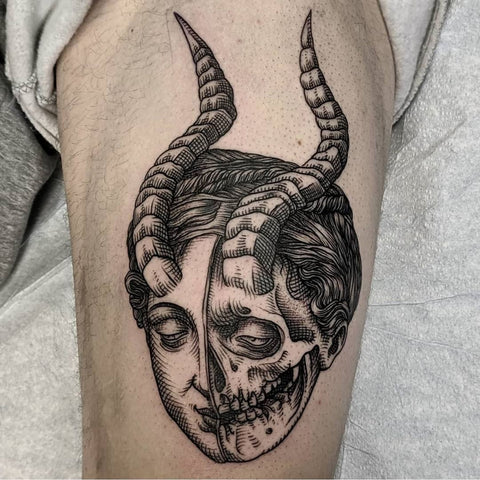 ram's horn men skull thigh tattoo