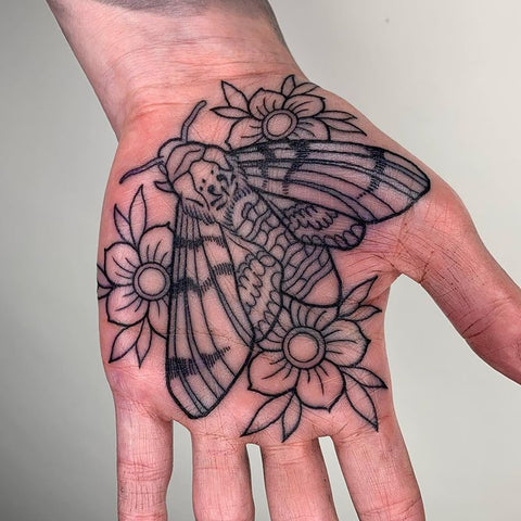 flower and bee moth tattoo on palm