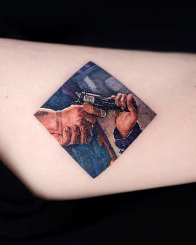 square frame gun tattoo