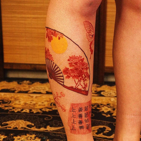red fan Chinese character leg tattoo
