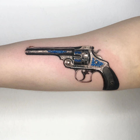 unique metallic gun tattoo