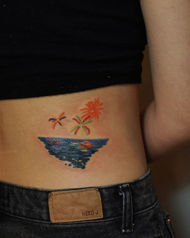 ocean sea firework tattoo on waist