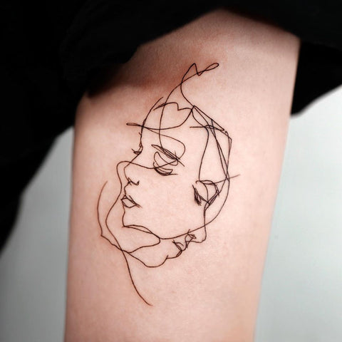 fine line face tattoo
