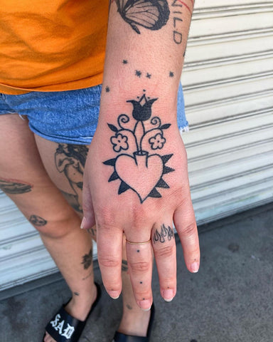 heart flower tattoo on the back of the hand