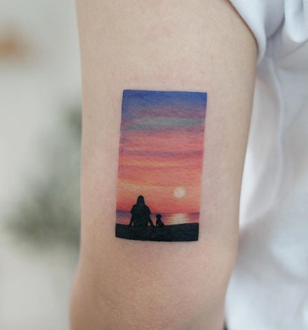 sunset tattoo on forearm