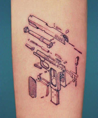 formation of a gun tattoo