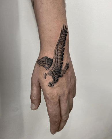 eagle tattoo on forearm