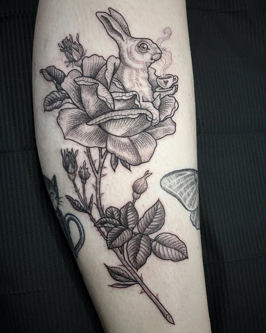 fine line flower rabbit tattoo