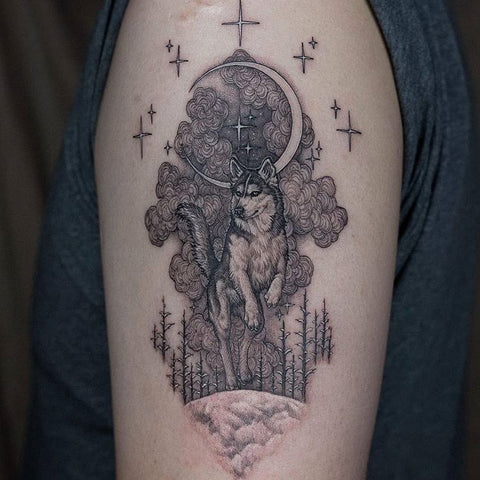 moon and wolf tattoo on arm