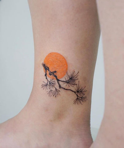 sun leaf tattoo design