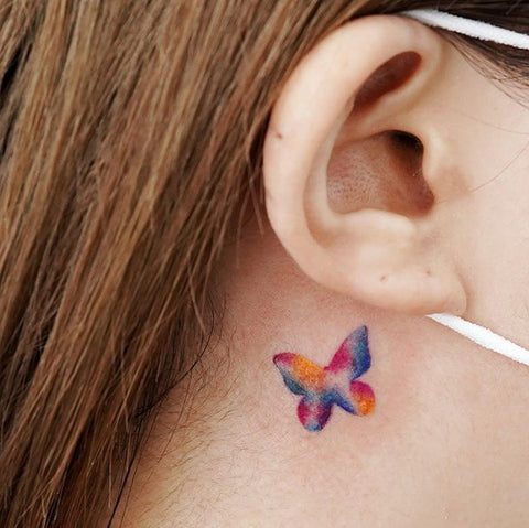 colorful butterfly neck tattoo