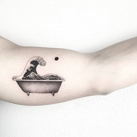 bath tub tattoo on arm
