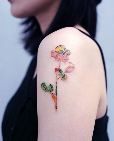 uniquely colored flower tattoo