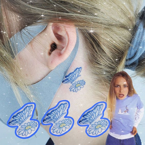 butterfly and flower etattoo behind the ear