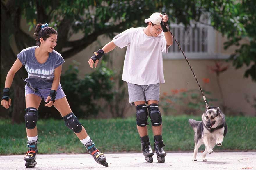 inline-skating-with-their-dog