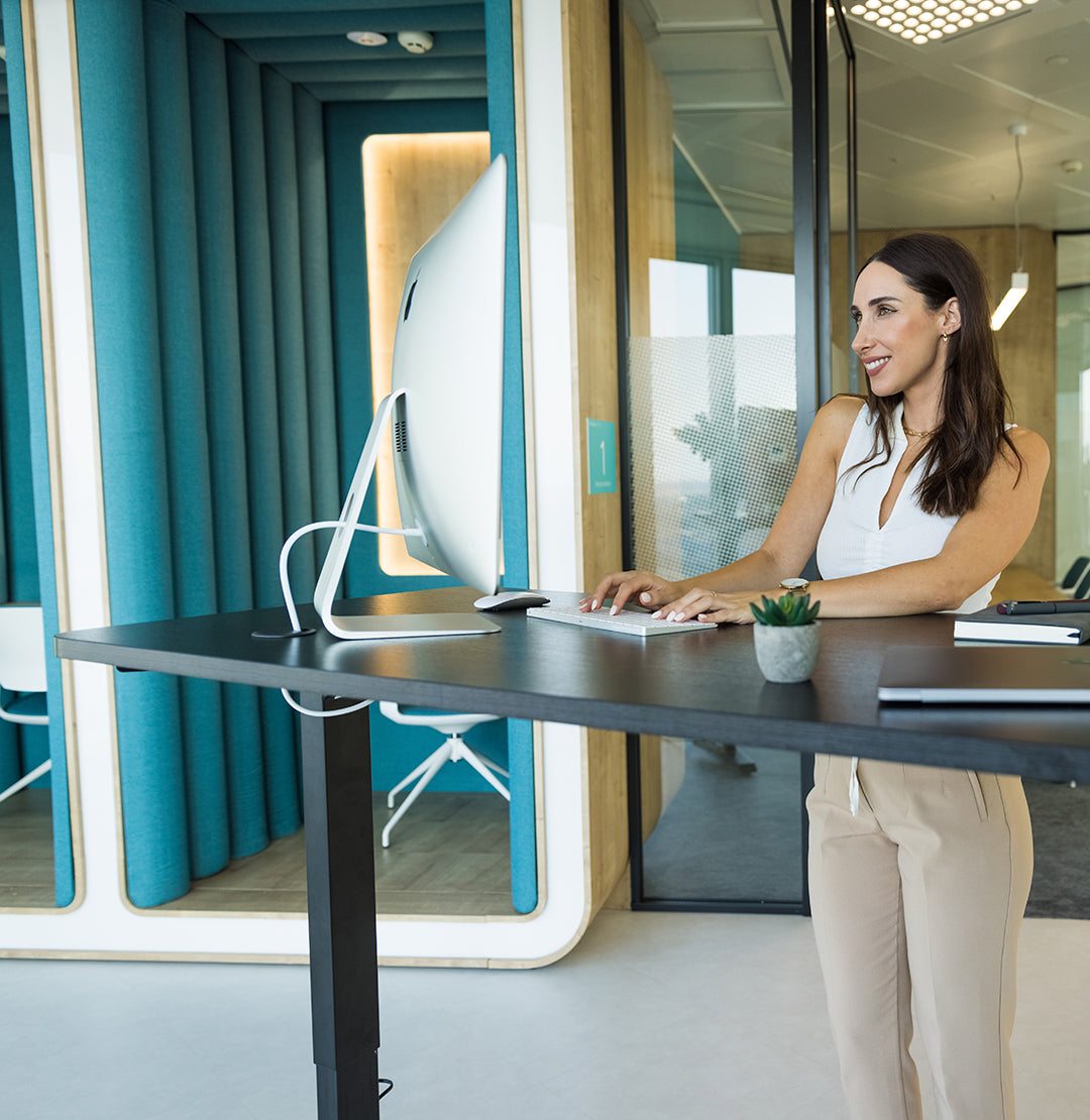 Young lady work at the standing desk