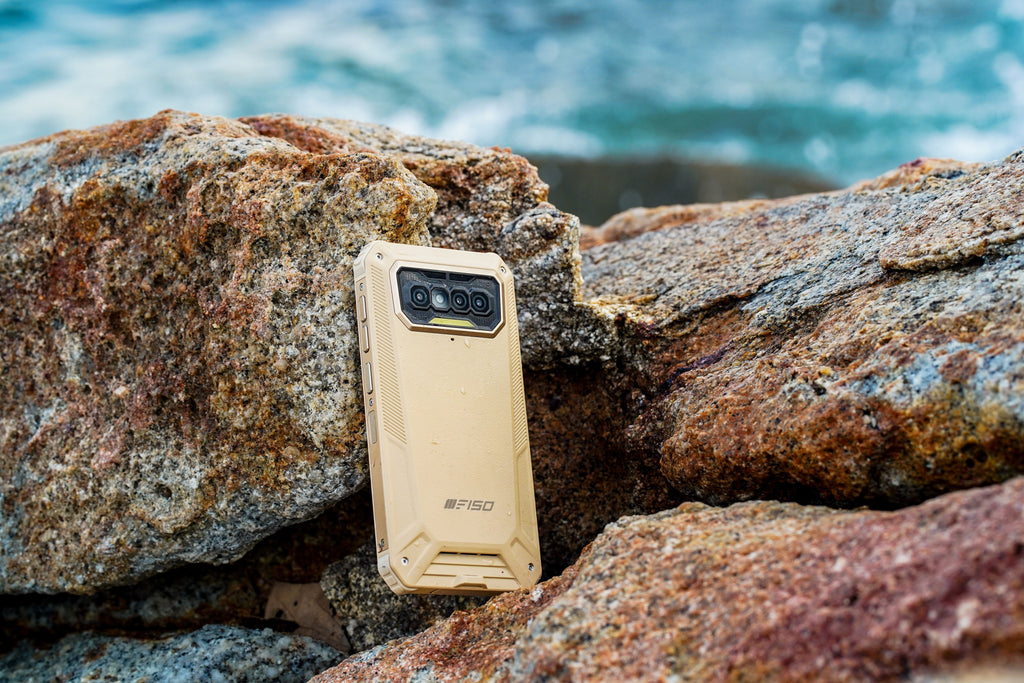 F150's B2021 rugged phones rest against a rock, the lines and octagonal rear design is on full display