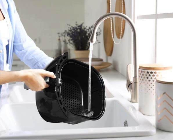 cleaning the basket of the air fryer